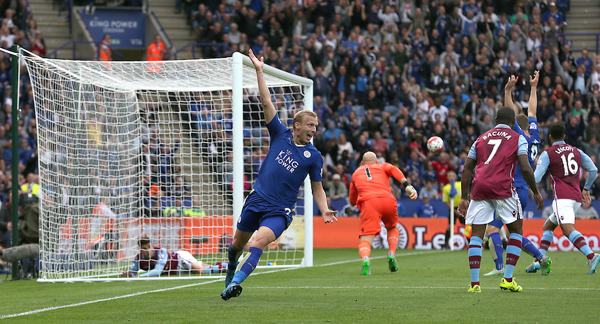 Leicester City's Ritchie De Laet celebrates scoring his sides first goal awarded by referee Mike Dean after it appeared that Aston Villa's Ashley Westwood might have headed his shot off the line<br /> <br /> Photographer Stephen White/CameraSport<br /> <br /> Football - Barclays Premiership - Leicester City v Aston Villa - Sunday 13th September 2015 - King Power Stadium - Leicester<br /> <br /> &copy; CameraSport - 43 Linden Ave. Countesthorpe. Leicester. England. LE8 5PG - Tel: +44 (0) 116 277 4147 - admin@camerasport.com - www.camerasport.com