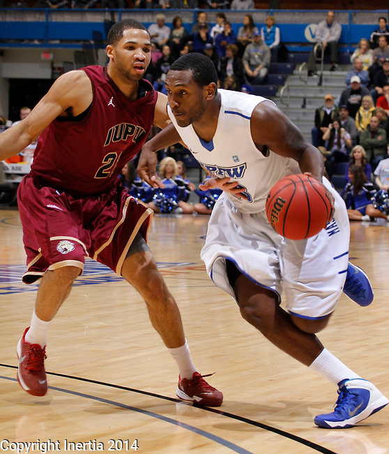 SIOUX FALLS, SD - MARCH 8:  Luis Jacobo #13 of IPFW drives into IUPUI defender Marcellus Barksdale #22 during their quarterfinal game at the 2014 Summit League Basketball Championships at the Sioux Falls Arena. (Photo by Dick Carlson/Inertia)