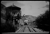RGS Goose stopped southbound at Coke Ovens water tank with Bridge 61-A in foreground.<br /> RGS  Coke Ovens, CO  Taken by Hilner, Ray C. - 8/18/1950