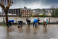 Pictured: Locals clean up flooded water from Sion Street, next to the river Taff in Pontypridd, Wales, UK. Sunday 16 February 2020<br /> Re: Storm Dennis has been affecting parts of Wales, UK.