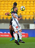 Wellington's Andrija Kaluderovic and Victory's Matias Sanchez compete for a header during the A-League football match between Wellington Phoenix and Melbourne Victory at Westpac Stadium in Wellington, New Zealand on Friday, 10 January 2018. Photo: Dave Lintott / lintottphoto.co.nz