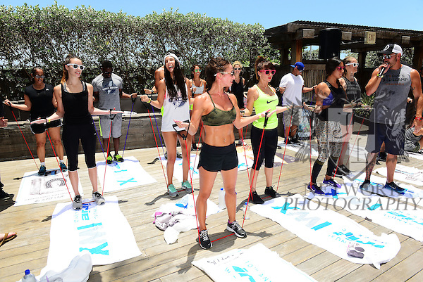 MIAMI BEACH, FL - JUNE 21: DJ Irie participate at a Barry's BootCamp workout by the pool side during Irie Weekend-IWX - BBQ Beach Bash Pool Party at National Hotel on Saturday June 21, 2014 in Miami Beach, Florida. (Photo by Johnny Louis/jlnphotography.com)
