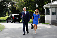 U.S. President Donald Trump walks with White House Press Secretary Kayleigh McEnany towards reporters on the South Lawn of the White House in Washington before his departure to Philadelphia on September 15, 2020. Photo by Yuri Gripas/ABACAPRESS.COM<br /> Credit: Yuri Gripas / Pool via CNP /MediaPunch