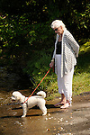 Eagles Mere Lake. Woman with little white dog