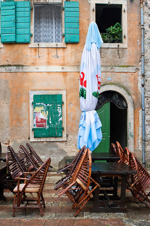 A cafe closed during a rainstorm in the Kotor's old city (stari grad), Montenegro