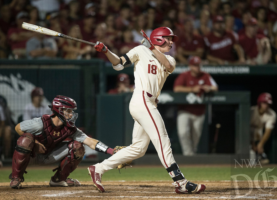 NWA Democrat-Gazette/BEN GOFF @NWABENGOFF<br /> Heston Kjerstad, Arkansas left fielder, hits a single in the 8th inning against South Carolina Saturday, June 9, 2018, during game one of the NCAA Super Regional at Baum Stadium in Fayetteville.