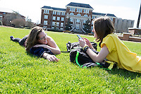 Student friends Katie Ray and Connie Taylor hanging out on the Drill Field grass.<br />  (photo by Megan Bean / &copy; Mississippi State University)