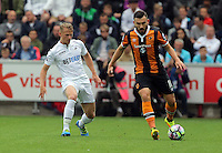 L-R Stephen Kingsley of Swansea City against Robert Snodgrass of Hull City during the Premier League match between Swansea City and Hull City at the Liberty Stadium, Swansea on Saturday August 20th 2016