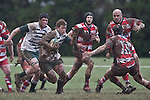 Mark Selwyn wrong foots Baden Kerr as he heads upfield. Counties Manukau Premier rugby game between Karaka & Manurewa played at the Karaka Domain on July 5th 2008..Karaka won 22 - 12.