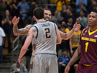 Justin Cobbs of California celebrates with Sam Singer of California after making a big play during the game against Arizona State at Haas Pavilion in Berkeley, California on January 29th, 2014.   Arizona State defeated California, 89-78.