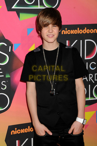 JUSTIN BIEBER .at the 23rd Annual Nickelodeon Kids' Choice Awards 2010 held at Pauley Pavilion in Westwood, California, USA, March 27th 2010 .arrivals kids half length black waistcoat t-shirt fringe necklace chain silver dog id tag  hands in pockets white wrist watch .CAP/ADM/BP.©Byron Purvis/Admedia/Capital Pictures