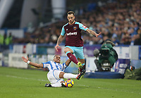 West Ham United's Marko Arnautovic is challenged by Huddersfield Town's Mathias Zanka Jorgensen<br /> <br /> Photographer Rob Newell/CameraSport<br /> <br /> The Premier League - Huddersfield Town v West Ham United - Saturday 13th January 2018 - John Smith's Stadium - Huddersfield<br /> <br /> World Copyright &copy; 2018 CameraSport. All rights reserved. 43 Linden Ave. Countesthorpe. Leicester. England. LE8 5PG - Tel: +44 (0) 116 277 4147 - admin@camerasport.com - www.camerasport.com