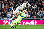 Karim Benzema of Real Madrid and Jose Manuel Reina of SSC Napoli in action during the match of Champions League between Real Madrid and SSC Napoli  at Santiago Bernabeu Stadium in Madrid, Spain. February 15, 2017. (ALTERPHOTOS)