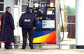 """Manassas, VA - October 10, 2002 --  Prince William County Police look over the crime scene at the Sunoco gas station in Manassas, VA  the morning after a Gaithersburg man was murdered while pumping gas at a Sunoco station.  It is still unclear if the man is another victim of the """"Beltway Sniper"""".  <br /> Credit: Ron Sachs / CNP<br /> (RESTRICTION: NO New York or New Jersey Newspapers or newspapers within a 75 mile radius of New York City)"""
