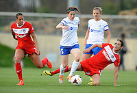 Boyds MD - April 19, 2014: Liz Bogus (5) of FC Kansas City goes against Yael Averbuch (4) of the Washington Spirit. The Washington Spirit defeated the FC Kansas City 3-1 during a regular game of the 2014 season of the National Women's Soccer League at the Maryland SoccerPlex.