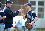 Muncy High School pitcher is congratulated by his coach