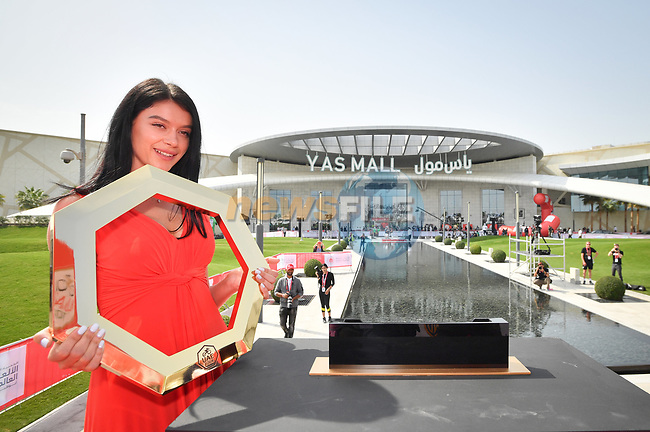 Podium girl with the trophy on stage at sign on before the start of Stage 2 of the 2019 UAE Tour, running 184km form Yas Island Yas Mall to Abu Dhabi Breakwater Big Flag, Abu Dhabi, United Arab Emirates. 25th February 2019.<br /> Picture: LaPresse/Massimo Paolone | Cyclefile<br /> <br /> <br /> All photos usage must carry mandatory copyright credit (© Cyclefile | LaPresse/Massimo Paolone)