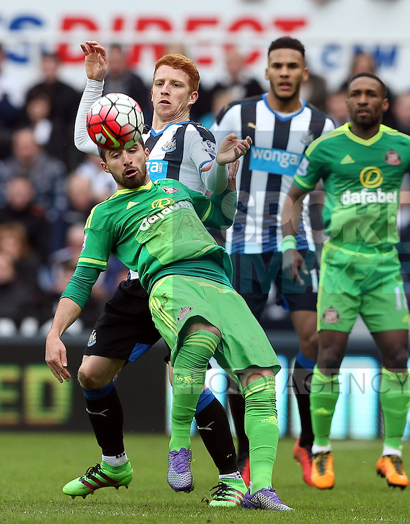 Newcastle United's Jack Colback, right, vies for the ball with Sunderland's Fabio Borini, left, during the Barclays Premier League match at St James' Park Stadium. Photo credit should read: Scott Heppell/Sportimage