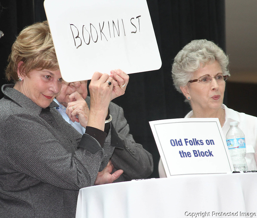 Old Folks on the Block team members Dolly Mullowney and Ginny Polio competes in the Great Grown-Up Spelling Bee at the South Shore plaza on Saturday October 18,2014. (Photo by Gary Wilcox)