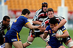Kristian Ormsby collars Callum Bruce duringthe Air NZ Cup game between Counties Manukau & Otago played at Mt Smart Stadium,Auckland on the 29th of July 2006. Otago won 23 - 19.