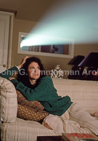Sherry Lansing, pioneering studio executive and first female movie studio head, watches film at home, Los Angeles, February 1989. Photo by John G. Zimmerman