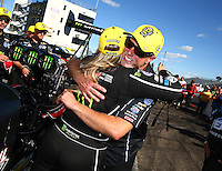Aug 21, 2016; Brainerd, MN, USA; NHRA top fuel driver Brittany Force celebrates with crew chief Brian Husen after winning the Lucas Oil Nationals at Brainerd International Raceway. Mandatory Credit: Mark J. Rebilas-USA TODAY Sports