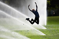 1st April 2020, Kohi Beach, Auckland, New Zealand;  Jumping in sprinklers at Madills Farm in the warm weather during the lockdown due to Covid-19. Kohimarama, Auckland, New Zealand on Wednesday 1 April 2020.