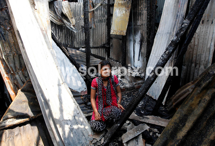 """**ALL ROUND EXCLUSIVE PICTURES FROM SOLARPIX.COM**                                             **WORLDWIDE SYNDICATION RIGHTS**                                                                                  Caption: A fire in a Mumbai slum has destroyed the one-room shack of Slumdog Millionaire child actress Rubina Ali, leaving her family homeless, Ali said..The fire also swept through hundreds of tenements late on Friday near railway tracks where Ali continued to live even after gaining global recognition. Nobody was hurt in the fire. Ali, who shot to international fame for her role in Danny Boyle's Oscar winning 2008 film Slumdog Millionaire, said she lost most of her belongings including precious photographs taken during her trip to Los Angeles for the Oscar ceremony..""""We only have a few clothes left, we tried hard to salvage whatever we could before the fire spread. My pictures at the Oscars, all my memories, are all gone,"""" Ali said as the rest of the family huddled under one blanket..Wisps of smoke rose from the slum as Ali and her family rummaged through the ashes, trying to salvage their possessions.                                                                              This pic: Rubina Ali                                                                                             JOB REF:12920        SJA       DATE: 03.03.2011                                                           **MUST CREDIT SOLARPIX.COM OR DOUBLE FEE WILL BE CHARGED**                                                                      **MUST AGREE FEE BEFORE ONLINE USAGE**                               **CALL US ON: +34 952 811 768 or LOW RATE FROM UK 0844 617 7637**"""