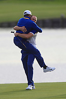 Alex Noren (Team Europe) celebrates with Thorbjorn Olesen (Team Europe) after winning his match on the 18th green during the Sunday Singles of the Ryder Cup, Le Golf National, Ile-de-France, France. 30/09/2018.<br /> Picture Thos Caffrey / Golffile.ie<br /> <br /> All photo usage must carry mandatory copyright credit (© Golffile | Thos Caffrey)