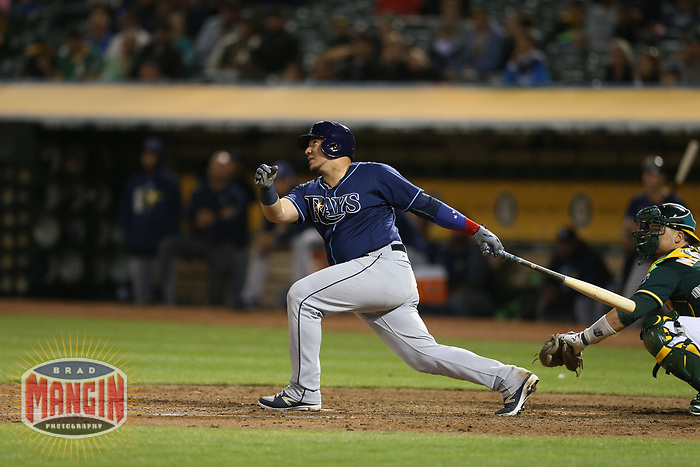 OAKLAND, CA - JULY 17:  Jesus Sucre #45 of the Tampa Bay Rays bats against the Oakland Athletics during the game at the Oakland Coliseum on Monday, July 17, 2017 in Oakland, California. (Photo by Brad Mangin)
