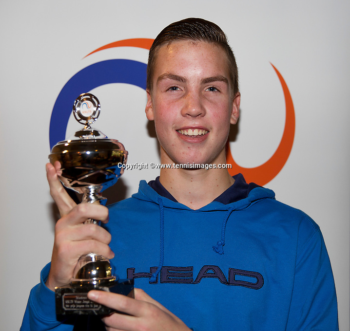 Almere, Netherlands, December 6, 2015, Winter Youth Circuit, Winner boys 14 years: Stijn Janssen with the trof<br /> Photo: Tennisimages/Henk Koster