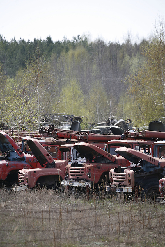 Chernobyl, Exclusion Zone, Ukraine. Wreckage of fire engines used by firemen to quench fire in  reactor. 27 firemen diedof of severe radiation sickness. The  Chernobyl Reactor, town, plant and environs just before the 20th anniversary of the nuclear disaster.