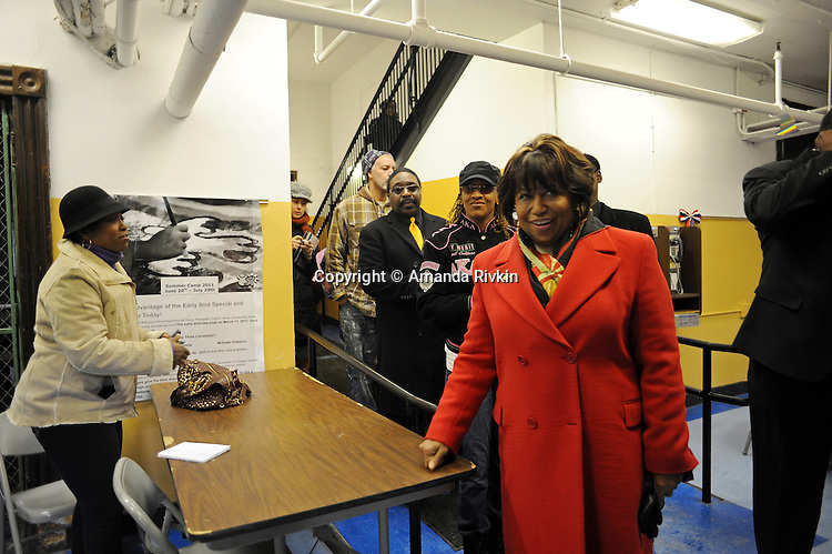 Candidate Carol Moseley Braun, a former U.S. Senator and Ambassador to New Zealand, enters Ray School in Hyde Park to vote in the Chicago mayoral elections in Chicago, Illinois on February 22, 2011.