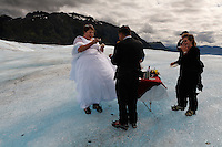 Wedding on the Mendenhall Glacier in  the Tongass National Forest.  A couple who met on the internet decided to be married in an unusual way--Diane Pearson of Pearson's Pond Spa and Inn arranges weddings by helicopter onto the glacier.