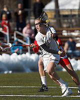 Boston College midfielder Sarah Mannelly (6) on the attack. .Boston College (white) defeated Boston University (red), 12-9, on the Newton Campus Lacrosse Field at Boston College, on March 20, 2013.