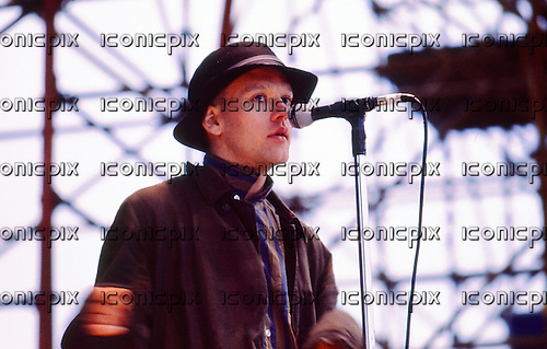 REM - vocalist Michael Stipe -  performing live on The Longest Day at The Bowl in Milton Keynes UK - 22 Jun 1985.  Photo credit: PG Brunelli/IconicPix