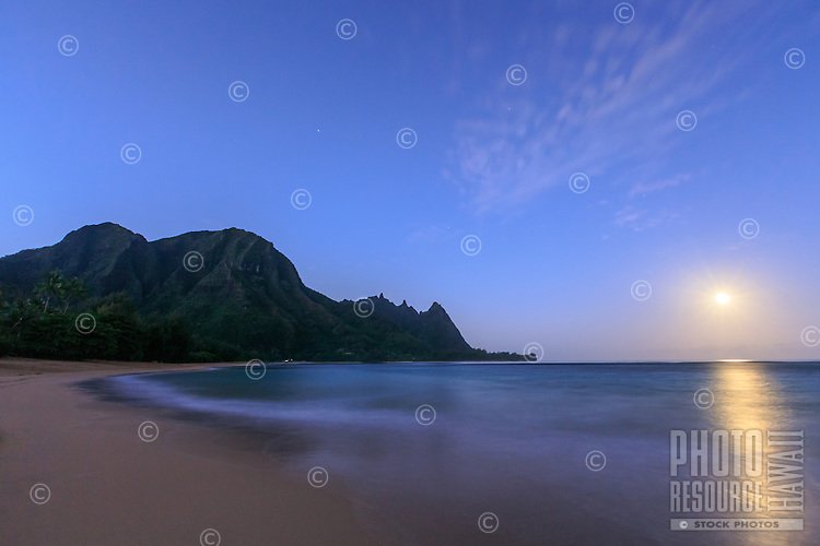 Tunnels Beach with a full moon in an early morning sky, North Kaua'i.