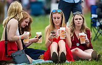 BALTIMORE, MD - MAY 20: A group of women sit in the grass of the infield before the start of racing on Preakness Stakes Day at Pimlico Race Course on May 20, 2017 in Baltimore, Maryland.(Photo by Scott Serio/Eclipse Sportswire/Getty Images)