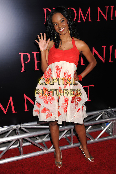 "DANA DAVIS.""Prom Night"" Los Angeles Premiere at the Cinerama Dome, Hollywood, California, USA..April 9th, 2008.full length white red pattern dress floral gold shoes hand on hip palm waving hand.CAP/ADM/BP.©Byron Purvis/AdMedia/Capital Pictures."