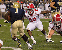 Youngstown State defensive end Josh Fenderson (99) tackles Pitt running back Ray Graham (1). The Youngstown St. Penguins defeated the Pittsburgh Panthers 31-17 on Saturday, September 1, 2012 at Heinz Field in Pittsburgh, PA.