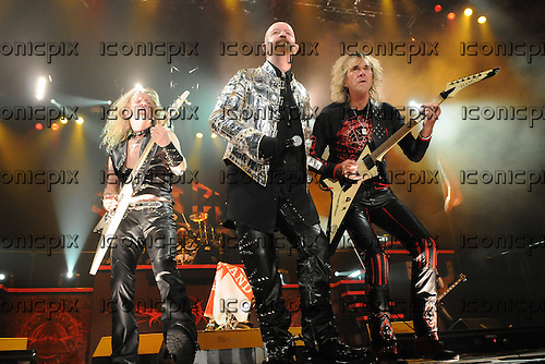 JUDAS PRIEST - L-R: KK Downing, Rob Halford, Glenn Tipton - performing live on the Priest Feast Tour of the UK at Wembley Arena in London  UK- 21 Feb 2009.  Photo credit: George Chin/IconicPix