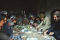 Iran 1979.Le dejeuner des peshmergas du PDKI dans un village.Iran 1979.Peshmergas of  KDPI having lunch in a village