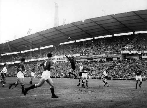 Goalkeeper Lev Yaschin (M, on top) punches away he centre before the English attackers and defender Boris Kusnezow (No. 4).  USSR wins the game in the world championship in Sweden on 17.06.1958 before 23,200 spectators in the Goeteborger Nya Ullevi stadium. This was the deciding match against England and the 1:0 win qualified USSR for the quarterfinal.