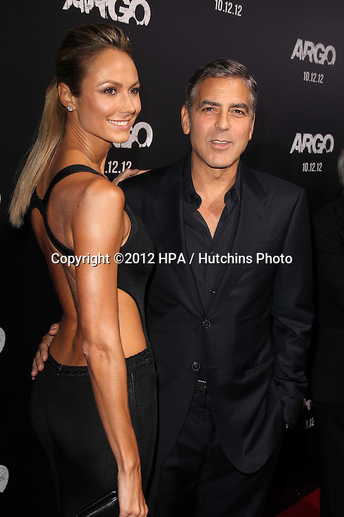 """LOS ANGELES - OCT 4:  Stacy Keibler, George Clooney arrives at the """"ARGO"""" Premiere at Samuel Goldwyn Theater on October 4, 2012 in Beverly Hills, CA"""