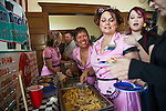 """Gina Renfroe, Deanna Lambka, and Alex Sanchez serve up """"Spam Diner Mac and Cheeae Casserole"""" from their mobile Spam Diner at the Isleton Spam Festival at Peter's Steakhouse in Isleton, California on Sunday, February 16th, 2014.  Photo/Victoria Sheridan"""