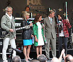 "NEW YORK, NY - JUNE 14:  Kelly Hansen of Foreigner with Hosts Gretchen Carlson; Steve Doocy and Brian Kilmeade at ""FOX & Friends"" All American Concert Series outside of FOX Studios on June 14, 2013 in New York City.  (Photo by Walter McBride/FilmMagic)"