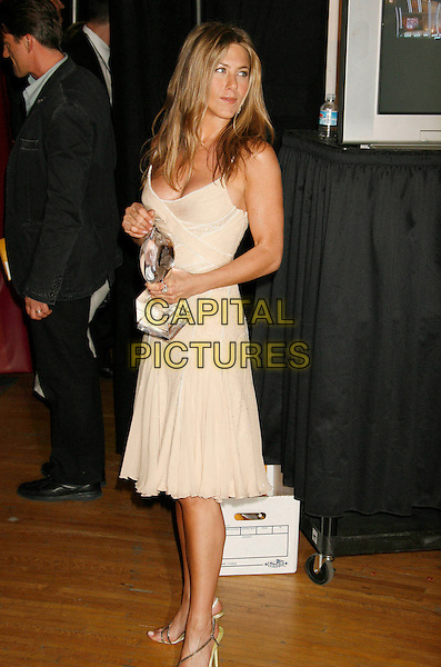 JENNIFER ANISTON.The 33rd Annual People's Choice Awards held at The Shrine Auditorium, Los Angeles, California, USA..January 9th, 2007.full length award trophy cream beige dress .CAP/ADM/RE.©Russ Elliot/AdMedia/Capital Pictures[
