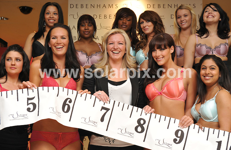 **ALL ROUND PICTURES FROM SOLARPIX.COM**.**WORLDWIDE SYNDICATION RIGHTS**.Ultimo's Bra Fit Clinic - Photocall - held at Debenhams London, UK. 28 April 2009..This pic: Lucy Clarkson, Michelle Mone and Katie Green, and 20 real women..JOB REF: 8910 SSD     DATE: 28_04_2009.**MUST CREDIT SOLARPIX.COM OR DOUBLE FEE WILL BE CHARGED**.**ONLINE USAGE FEE GBP 50.00 PER PICTURE - NOTIFICATION OF USAGE TO PHOTO @ SOLARPIX.COM**.**CALL SOLARPIX : +34 952 811 768 or LOW RATE FROM UK 0844 617 7637**