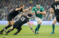 19th November 2016 | IRELAND vs NEW ZEALAND<br /> <br /> CJ Stander on the attack is tackled by Malakai Fekitoa and Joe Moody during the Autumn Series International clash between Ireland and New Zealand at the Aviva Stadium, Lansdowne Road, Dublin,  Ireland. Photo by John Dickson/DICKSONDIGITAL