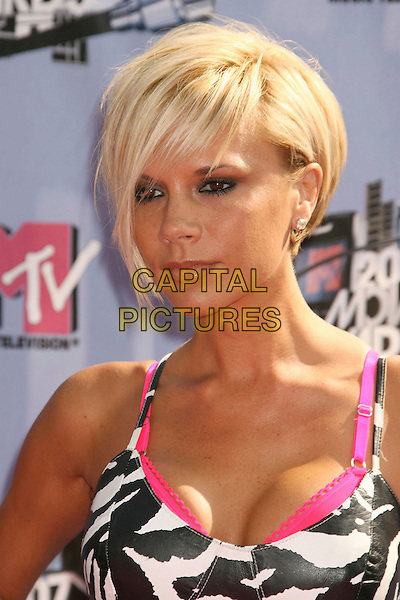 VICTORIA BECKHAM .2007 MTV Movie Awards held at the Gibson Amphitheater, Universal City, California, USA..June 3rd, 2007.headshot portrait cleavage pink bra white black .CAP/ADM/RE.©Russ Elliot/AdMedia/Capital Pictures *** Local Caption *** ...